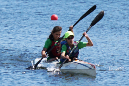 2 Female Paddlers in a K2 Race paddling in unison
