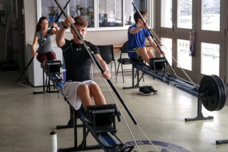Young Athletes training indoors on Stationary Kayak Machines